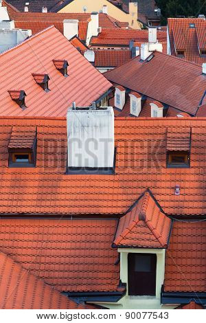 Red Tiled Roofs Of Different Buildings In Prague