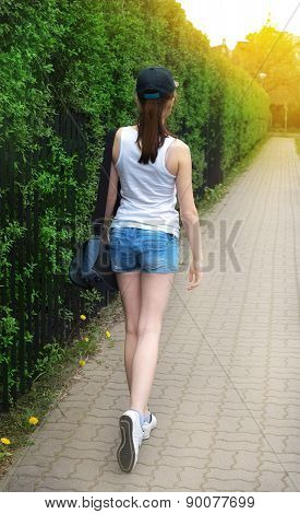strolling girl in blue cap