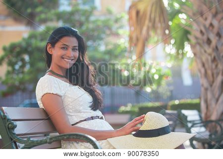 Sophisticated Woman Chilling On Bench