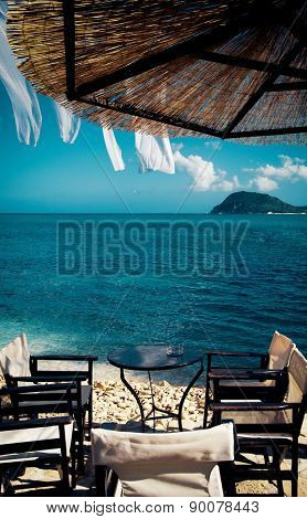 outdoor cafe bar table at Cameo beach, Zakynthos (Greece)