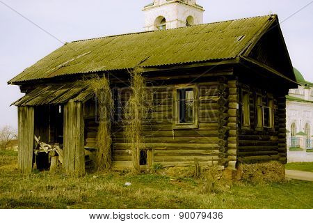 Empty wooden house in the Russian village on a background of chu