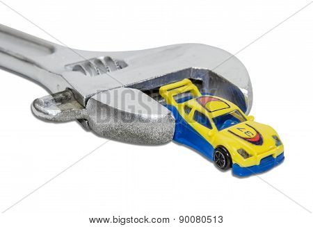 Adjustable Wrench And A Toy Car
