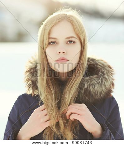 Closeup Portrait Of Pretty Blonde Girl Outdoors In Winter Day