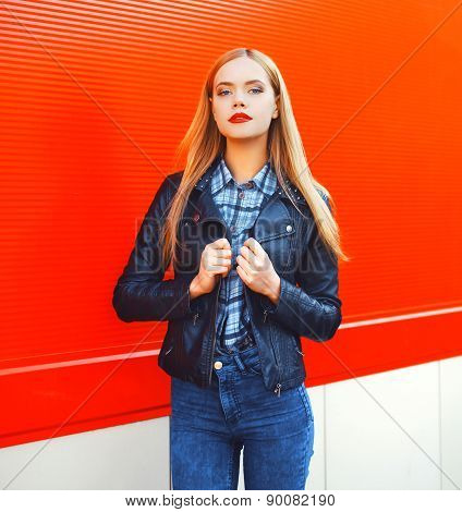 Fashion Portrait Of Sexy Beautiful Blonde Woman With Red Lipstick Wearing A Rock Black Leather Jacke