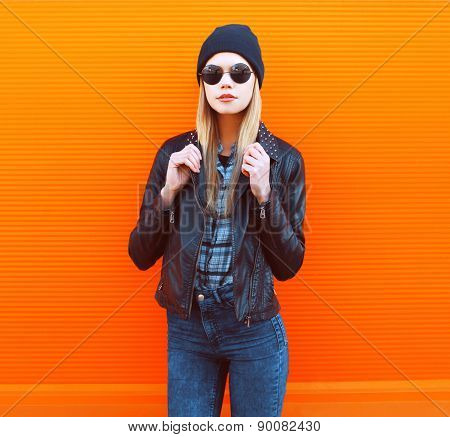 Fashion Portrait Of Stylish Woman In Rock Black Style Posing Against A Colorful Urban Wall