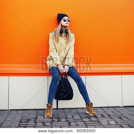 Outdoor Fashion Portrait Of Stylish Hipster Cool Girl Wearing A Black Hat And Sunglasses With Backpa
