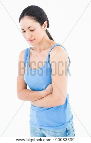 Pretty woman suffering from stomach pain on white background