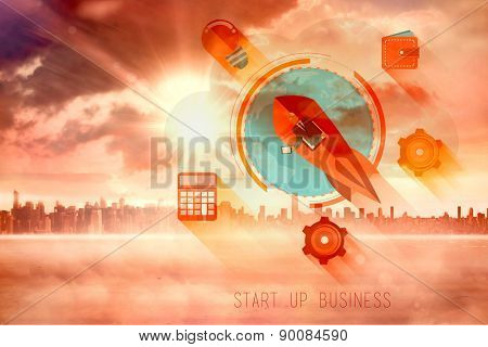 start up business graphic against sun shining over city