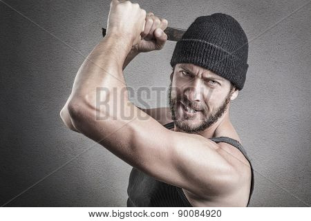 Violent Man Using A Spanner Or Wrench As A Weapon