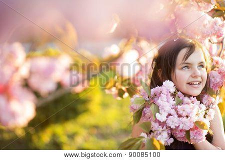 Little Girl Amid Cherry Flowering