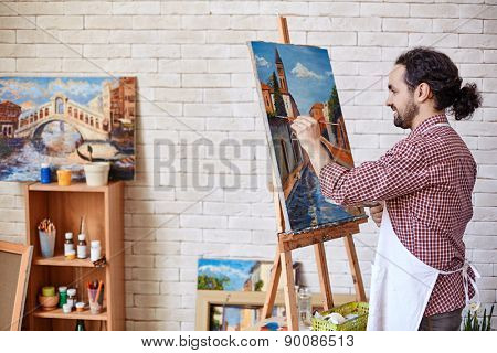 Handsome painter working in his studio