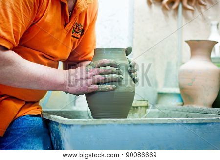 People At Work: The Production Of Ceramic Vases On A Potter's Wheel.
