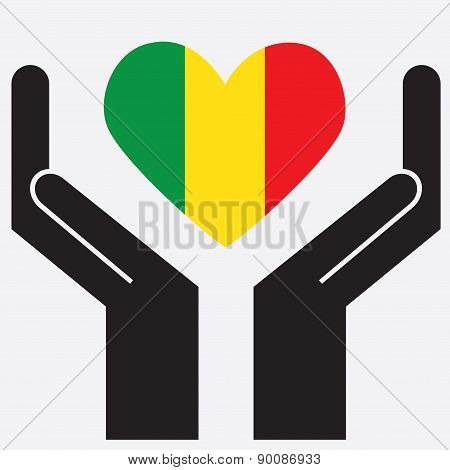 Hand showing Mali flag in a heart shape.