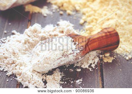 Gluten free chickpeas flour in wooden scoop