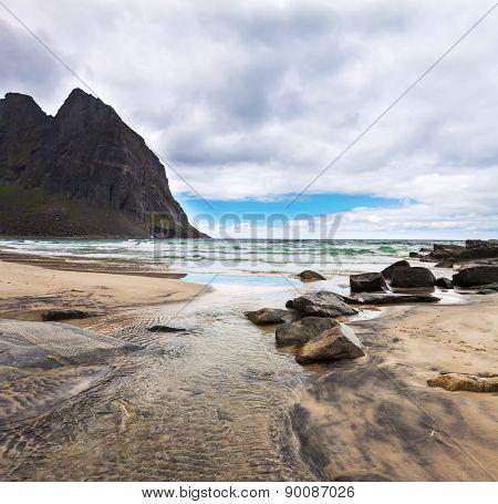 Paradise Kvalvika beach on Lofoten islands in Norway