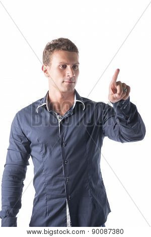 Attractive young man pressing imaginary button in the air