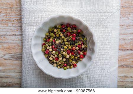 Colored Peppercorns In A White Bowl