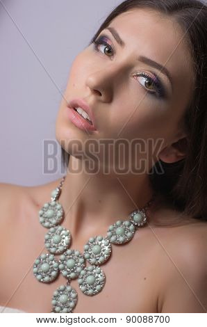 Young girl with makeup in luxury jewelry