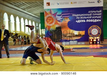 ST. PETERSBURG, RUSSIA - MAY 6, 2015: Unidentified wrestlers during International freestyle wrestling tournament Victory Day. This traditional competitions dedicated to the Victory in WWII