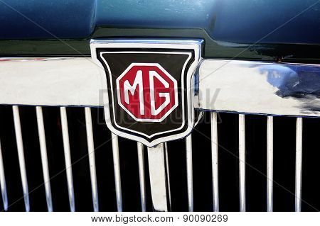 Detail Of The Mg Brand On An Old Car Radiator