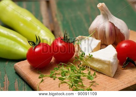 Cress, Camembert And Tomatoes On Chopping Board