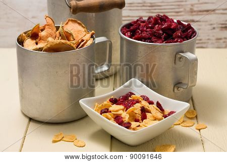 Square Bowl With Cornflakes In Front Of Two Old Cups
