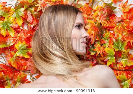 Young Blonde Model Lying On Leaves
