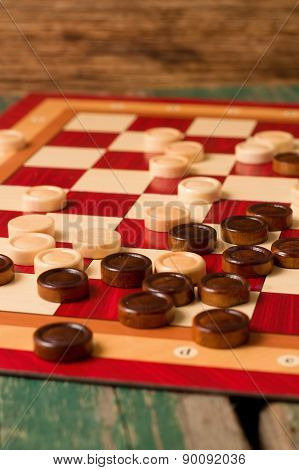 Wooden Stones On Board For Game Of Checkers