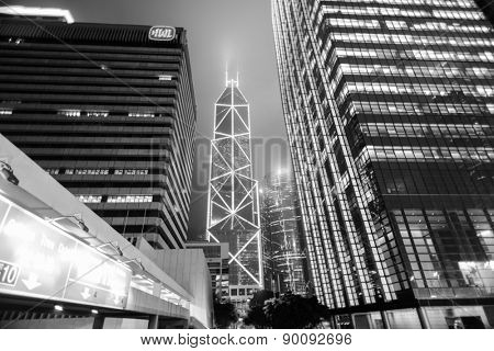 HONG KONG - APRIL 21: Hong Kong downtown skyscrapers at night on April 21, 2014 in Hong Kong, China. Hong Kong alternatively known by its initials H.K., is situated on China's south coast.