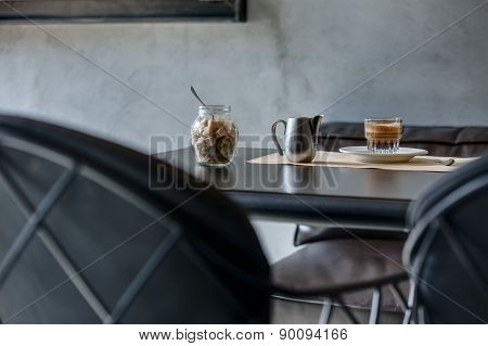 Espresso on black glossy table