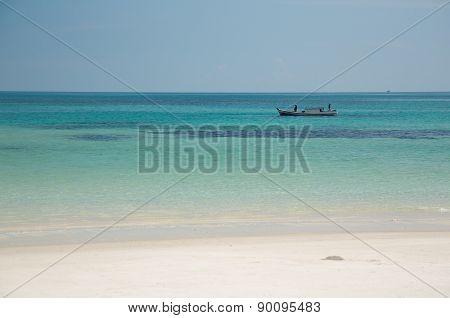 Sandy beach, green sea fisher ship