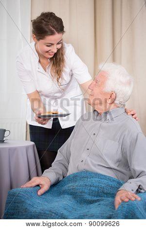 Caring Nurse And Older Man