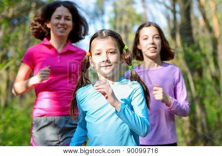 Family sport, happy active mother and kids jogging outdoors