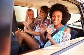 stock photo of road trip  - Three Women Sitting In Rear Seat Of Car On Road Trip - JPG