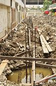 picture of reinforcing  - Metal rods bars reinforcement for concrete pole at construction site - JPG
