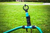 picture of sprinkler  - Old and DIY sprinkler on the grass - JPG