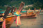 stock photo of phi phi  - Thai traditional boats on Phi - JPG