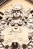 image of stone sculpture  - stone facade on classical building with ornaments and sculptures - JPG