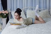picture of short-story  - Brunette with a book in the room - JPG