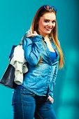 foto of denim jeans  - Fashion and shopping. Woman long hair wearing denim with bag. Attractive girl holding handbag with jeans clothes buying. Blue color