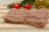 picture of rice noodles  - Brown rice noodles on the wood board - JPG