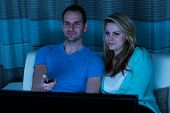 pic of watching movie  - Happy Couple With Remote Control Watching Movie At Home - JPG
