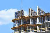 pic of formwork  - Crane hoisting formwork over construction site work - JPG