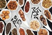 stock photo of yin  - Chinese herbal medicine selection with yin yang calligraphy script on rice paper - JPG