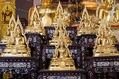 picture of buddha  - Golden Buddha statue names Buddhachinaraj sit on layer respectively the most beautiful buddha image of Thailandcan use religious concept background - JPG