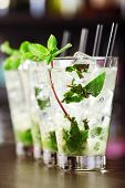 foto of mojito  - Mojito cocktail shot on a bar counter in a nightclub - JPG