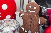 stock photo of gingerbread man  - Gingerbread man cookies star anise cinnamon and cookbook - JPG