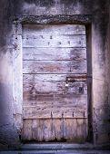foto of wooden door  - old wooden door of an empty house - JPG
