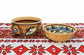 picture of ceramic bowl  - Two ceramic bowl with floral ornaments on the tablecloth with a white background - JPG