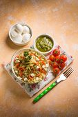 image of pesto sauce  - vegetarian couscous with mozzarella tomatoes and pesto sauce - JPG